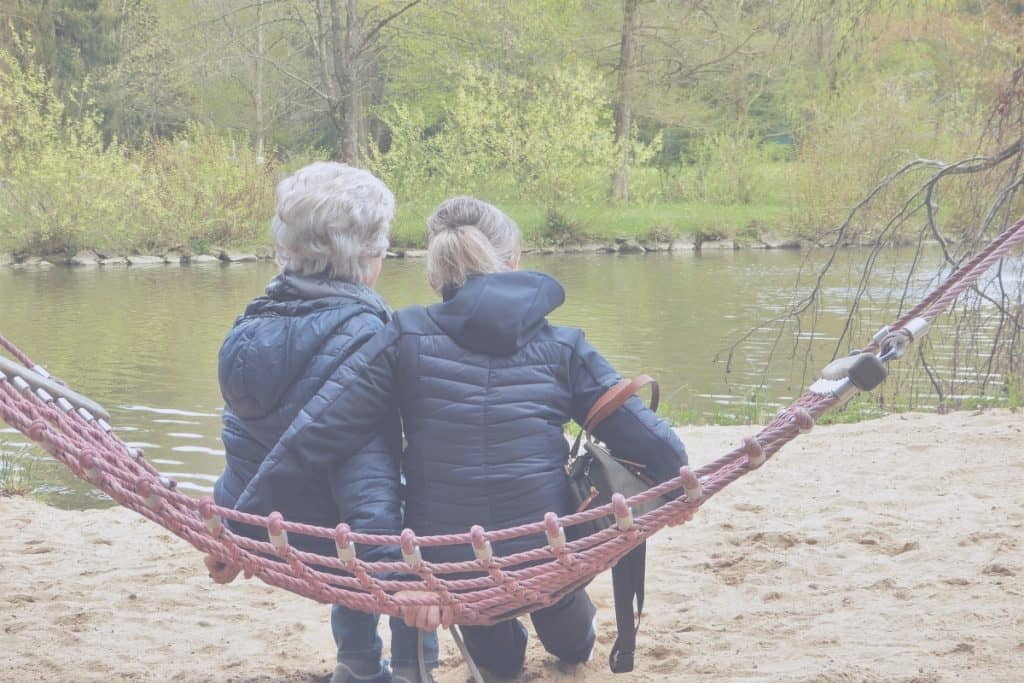 parent and adult caregiver child on a hammock
