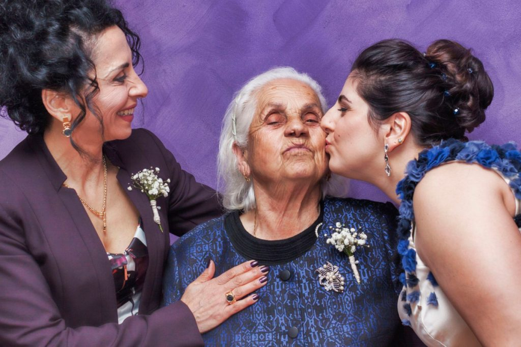 two daughters with their senior mother